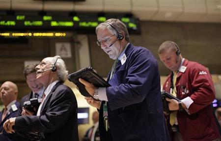 Traders work on the floor of the New York Stock Exchange September 28, 2011. REUTERS/Brendan McDermid