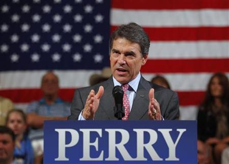 Republican presidential candidate Texas Governor Rick Perry speaks at a town hall meeting in Derry, New Hampshire September 30, 2011. REUTERS/Brian Snyder