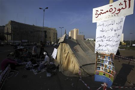 Egyptian protesters attend an early morning sit-in at Tahrir Square in Cairo October 1, 2011. The banner reads ''Continue the Revolution''. REUTERS/Mohamed Abd El-Ghany