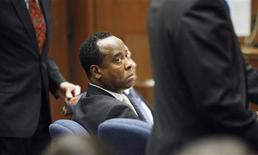 <p>Dr. Conrad Murray watches his former patient, Robert Russell, testify during Murray's involuntary manslaughter trial in the death of pop star Michael Jackson in Los Angeles, September 30, 2011. REUTERS/Al Seib/Pool</p>
