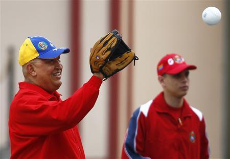 Venezuela's President Hugo Chavez plays softball before a press conference at Miraflores Palace in Caracas September 29, 2011. REUTERS/Carlos Garcia Rawlins