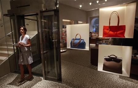 An employee walks out of an elevator inside a Hermes showroom in Mumbai August 23, 2011. REUTERS/Danish Siddiqui