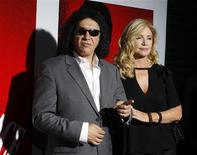 "<p>Gene Simmons of the band Kiss and actress Shannon Tweed arrive at the Blu-ray disc launch party for the 1983 classic film ""Scarface"" in Los Angeles, California August 23, 2011. REUTERS/Fred Prouser</p>"