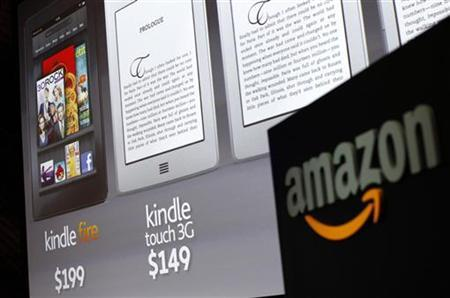 Graphics of the new Amazon Kindle tablets are seen at a news conference during the launch of Amazon's new tablets in New York, September 28, 2011. REUTERS/Shannon Stapleton