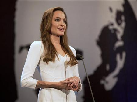 United Nations High Commissioner for Refugees (UNHCR) Goodwill Ambassador Angelina Jolie presents the Nansen prize to Yemen's Society for Humanitarian Solidarity and its founder, Nasser Salim Ali Al-Hamairy (not pictured) at a ceremony in Geneva October 3, 2011. REUTERS/Jason Tanner/UNHCR/Handout