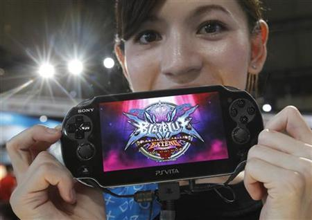 A promotional woman shows a Sony's PlayStation Vita handheld gaming device at Tokyo Game Show in Chiba, east of Tokyo, September 15, 2011. REUTERS/Kim Kyung-Hoon
