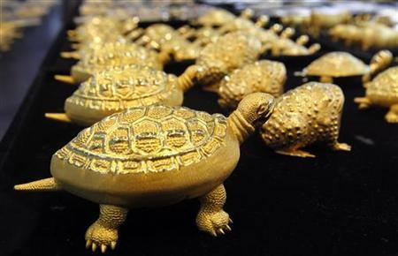 Gold turtles and toads are displayed at a jewellery shop in Seoul April 21, 2011. REUTERS/Jo Yong-Hak