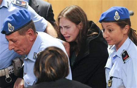 Amanda Knox reacts after hearing the verdict during her appeal trial in Perugia October 3, 2011. REUTERS/Tiziana Fabi/Pool