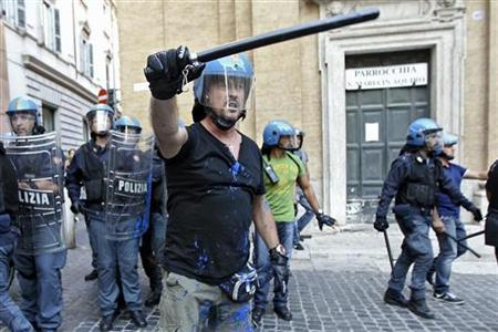 Anti riot police react during clash with anti-austerity protesters near the Italian Parliament building in downtown Rome September 14, 2011. REUTERS/Stringer
