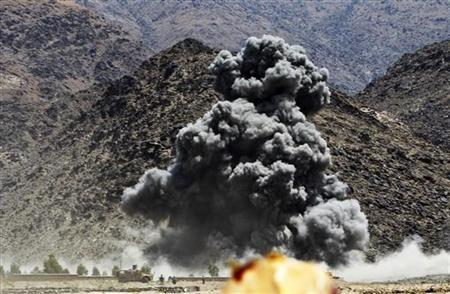 An explosion is seen after airstrikes by NATO-led forces during fighting between the Afghan and foreign troops and the Taliban insurgents in Shewa district of Nanagarhar province July 17, 2011. REUTERS/Parwiz