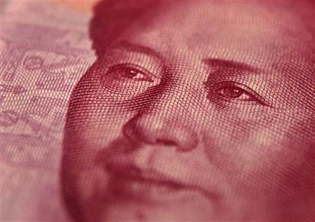 Late Chinese leader Mao Zedong is seen on a 100 yuan (15 USD) banknote in this photo illustration taken in Beijing December 9, 2010. REUTERS/Petar Kujundzic