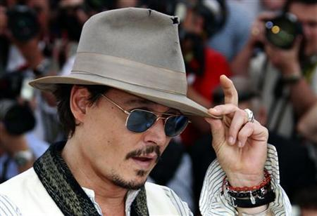 Cast member Johnny Depp poses during a photocall for the film ''Pirates Of The Caribbean: On Stranger Tides'' at the 64th Cannes Film Festival, May 14, 2011. REUTERS/Eric Gaillard
