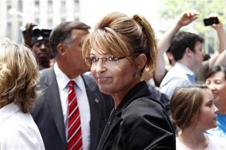 Sarah Palin walks to her ''One Nation Tour'' bus after a visit to Fox News headquarters in New York, June 1, 2011. REUTERS/Gary Hershorn
