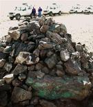 <p>A traditional cairn of stones, including copper-rich ore, stands on the site of Oyu Tolgoi copper and gold mine in Mongolia November 10, 2007. REUTERS/Tom Miles</p>