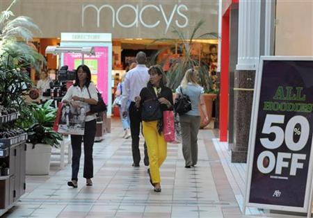Shoppers carrying bags walk at the Pentagon City Shopping Mall in Arlington, Virginia, September 15, 2009. REUTERS/Mike Theiler
