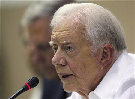 Former U.S. President Jimmy Carter addresses a news conference in Havana March 30, 2011. REUTERS/Enrique De La Osa