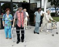 <p>Residents of the Century Village retirement community in Deerfield Beach, Florida leave a polling station after voting in this November 2, 2004 file photo. REUTERS/Gary I Rothstein/Files</p>