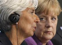 <p>International Monetary Fund (IMF) Managing Director Christine Lagarde (L) and German Chancellor Angela Merkel address a news conference after meeting to discuss reform of the international monetary system in Berlin October 6, 2011. REUTERS/Fabrizio Bensch</p>