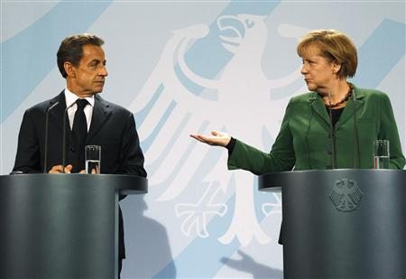 French President Nicolas Sarkozy (L) and German Chancellor Angela Merkel address a news conference at the Chancellery in Berlin October 9, 2011. REUTERS/Fabrizio Bensch
