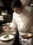 <p>Award-winning chef Michael Mina prepares a dish at the Bourbon Steak restaurant in Washington, in this undated handout. REUTERS/Mina Group/Handout</p>