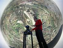 <p>Geert Matthys, research and development manager at Barco, a Belgian company specialising in high-definition projectors and displays, gives an explanation inside a fully immersive 360-degree flight simulator in Kuurne, October 11, 2011. REUTERS/Yves Herman</p>