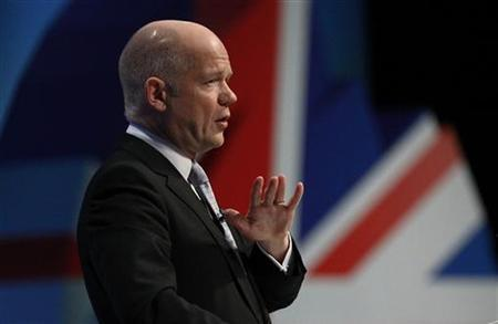 Foreign Secretary William Hague gestures during his keynote speech on the final day of the Conservative Party annual conference in Manchester, October 5, 2011. REUTERS/Phil Noble
