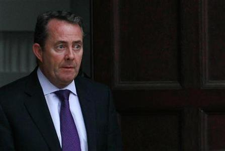 Defence Secretary Liam Fox leaves his residence in central London October 13, 2011. REUTERS/Suzanne Plunkett