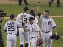 <p>Detroit Tigers players (L-R) Ryan Raburn, Don Kelly, Brandon Inge and Phil Coke celebrate after they defeated the Texas Rangers in Game 5 in their MLB ALCS baseball playoffs in Detroit, Michigan, October 13, 2011. REUTERS/Mark Blinch</p>