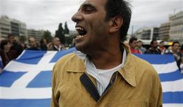 "<p>A man shouts slogans during a rally of the ""Indignant"" group in front of the parliament in Athens October 15, 2011. REUTERS/Yiorgos karahalis</p>"