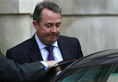 In this file picture, Defence Secretary Liam Fox leaves his residence in central London October 13, 2011. REUTERS/Suzanne Plunkett