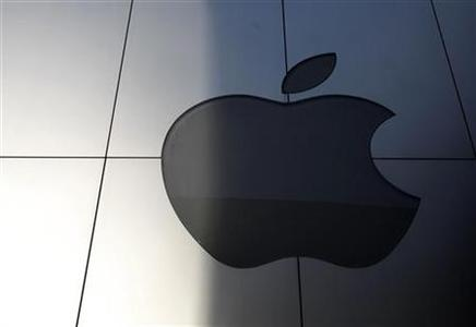 An Apple logo is seen with its light switched off to mourn the death of former Apple Inc CEO Steve Jobs, at an Apple store in Tokyo October 6, 2011. REUTERS/Yuriko Nakao