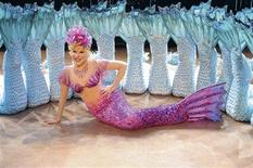 <p>Singer Bette Midler is shown wearing her famous mermaid stage costume as the character Delores de Lago in this undated publicity photograph released to Reuters October 18, 2011. The Mermaid costume and the Valentino gown she wore to the 1992 Oscars and a collection of headdresses are all going up for auction in November, Julien's Auctions said on Tuesday. Midler is also is selling several stage costumes designed by Bob Mackie and outfits she wore on album covers dating back to the 1970s, at the auction set for November 12, 2011 in Beverly Hills. REUTERS/Courtesty Julien's Auctions/Handout</p>