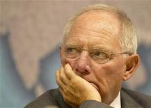<p>German finance minister Wolfgang Schauble listens at Chatham House in central London October 17, 2011. REUTERS/Olivia Harris</p>