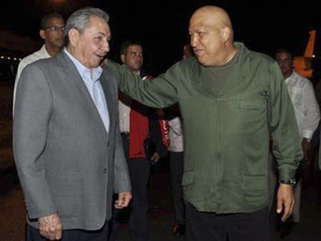 Cuba's President Raul Castro (L) and Venezuela's President Hugo Chavez meet at Havana's Jose Marti airport in this handout picture taken October 16, 2011. REUTERS/Revolution Studios/Cubadebate/Handout