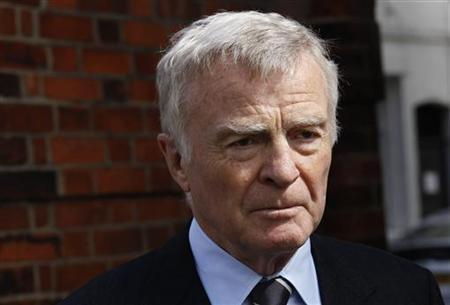 Former motorsport chief Max Mosley listens to questions during a television interview outside his office in London May 10, 2011. REUTERS/Suzanne Plunkett