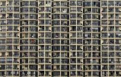 <p>A view of a residential building in Shanghai in this file picture taken, March 18, 2009. REUTERS/Stringer</p>