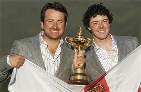 European Ryder Cup players Graeme McDowell (L) and Rory McIlroy of Northern Ireland pose after the European team won the 2010 Ryder Cup at Celtic Manor in Newport, south Wales October 4, 2010. REUTERS/Eddie Keogh
