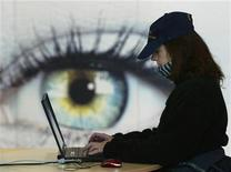 <p>A women uses her laptop at the booth of IBM at the world's largest computer fair CeBIT in Hanover March 9, 2005. TECOM REUTERS/Fabrizio Bensch</p>