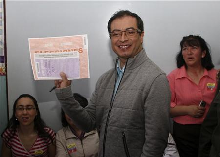 Progresistas Party's candidate for mayor of Bogota Gustavo Petro (C) reacts after casting his vote in a school in Bogota October 30, 2011. REUTERS/John Vizcaino