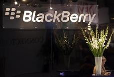 <p>A RIM hostess uses her Blackberry device at the ITU Telecom World in Geneva October 24, 2011. REUTERS/Denis Balibouse</p>