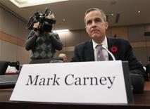 <p>Bank of Canada Governor Mark Carney waits to testify before the Commons finance committee in Ottawa November 1, 2011. REUTERS/Chris Wattie</p>