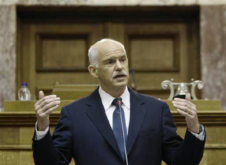 Greek Prime minister George Papandreou delivers a speech to Panhellenic Socialist Movement (PASOK) parliamentary group at the parliament in Athens October 31, 2011.  REUTERS/John Kolesidis