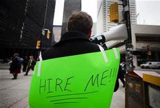 <p>A man with a sign strapped to his back uses a megaphone to attract the attention of potential employers as he hands out resumes on Bay Street in the financial district in Toronto, March 5, 2009. REUTERS/Mark Blinch</p>