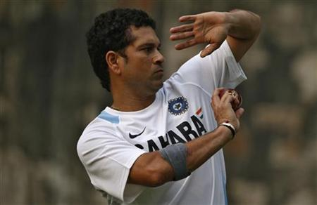 India's Sachin Tendulkar bowls during a practice session ahead of their first test cricket match against West Indies in New Delhi November 5, 2011. REUTERS/Stringer