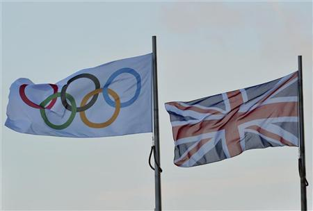 An Olympic flag flies next to the British union flag in central London February 9, 2011. REUTERS/Toby Melville