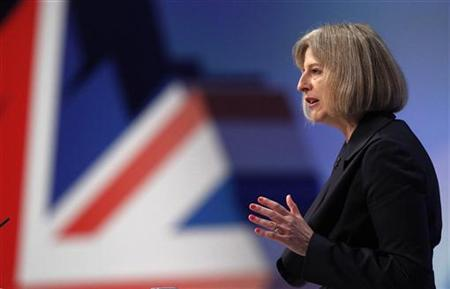 Britain's Home Secretary Theresa May delivers her address on the third day of the Conservative Party Conference in Manchester, northern England October 4, 2011. REUTERS/Phil Noble