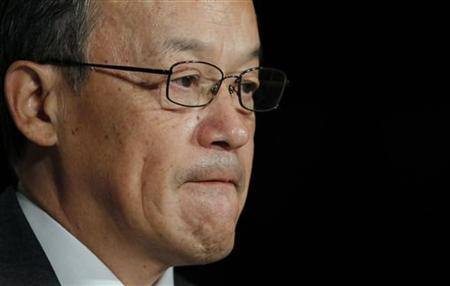Olympus Corp's President Shuichi Takayama reacts at a news conference in Tokyo November 8, 2011. Japan's Olympus admitted for the first time on Tuesday that controversial acquisitions had been used to cover up losses on securities investments dating back to the 1980s, succumbing to weeks of pressure that has battered the company's share price. REUTERS/Toru Hanai