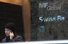 <p>A man talks on the phone inside the office complex where MF Global Holdings Ltd have an office on 52nd Street in midtown Manhattan New York, October 31, 2011. REUTERS/Brendan McDermid</p>