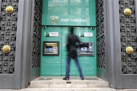 A man approaches a cash machine at France's biggest listed bank BNP Paribas in Paris, November 3, 2011. REUTERS/Gonzalo Fuentes