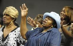 <p>Bethel Baptist Church of Pratt City church members Rosilind Brown (L) and Paulette Williams pray during a service held at Fair Park Arena due to their church being destroyed in Birmingham, Alabama, May 1, 2011. REUTERS/Tami Chappell</p>
